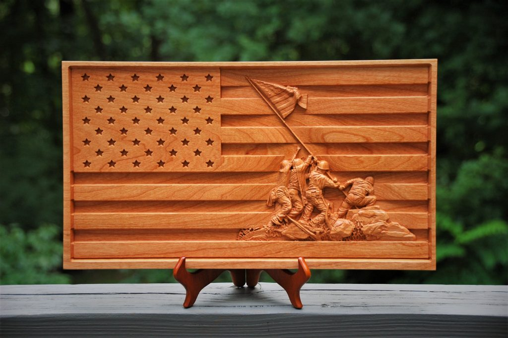 US flay with Iwo Jima flag raising carving